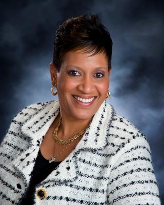 Ms. Tanya Young, Principal Baum School, wearing white pattern jacket